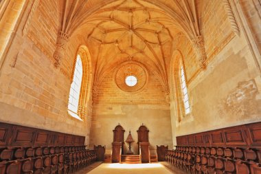 The magnificent chapel with a rows of oak chairs