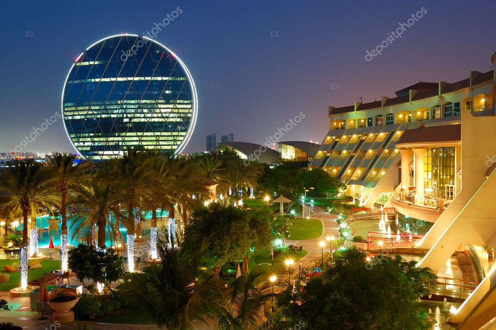 Night illumination in the luxury hotel and circular building, Ab