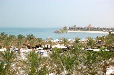 Recreation area of luxury hotel and beach with luxury villas, Ra