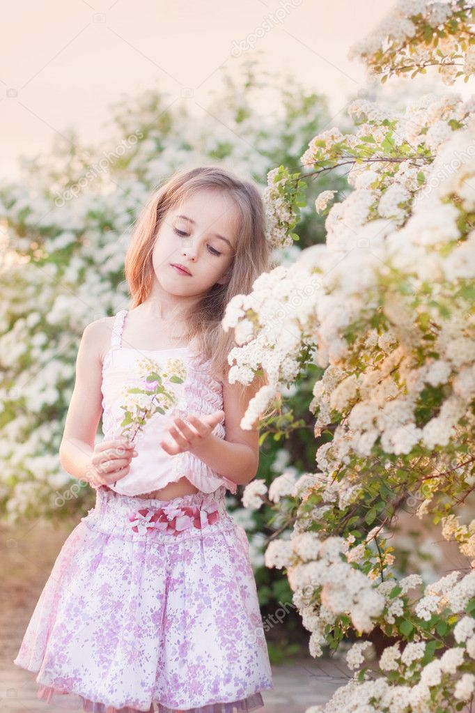 Beautiful girl in garden ⬇ Stock Photo, Image by