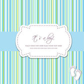Photo Baby boy arrival card with two foot steps on polka dot background
