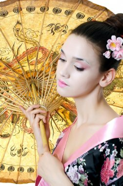 The beautiful girl with a make-up of the Japanese