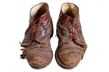 Old worn out boots, isolated