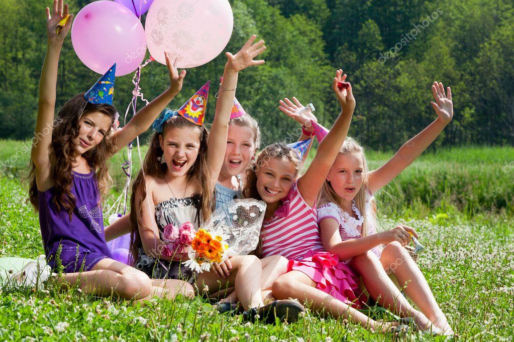 Beautiful girls celebrate birthday outdoors
