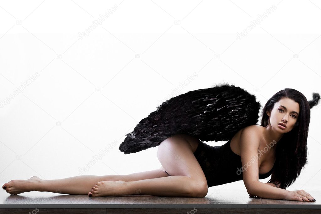 Angel with wings in white background