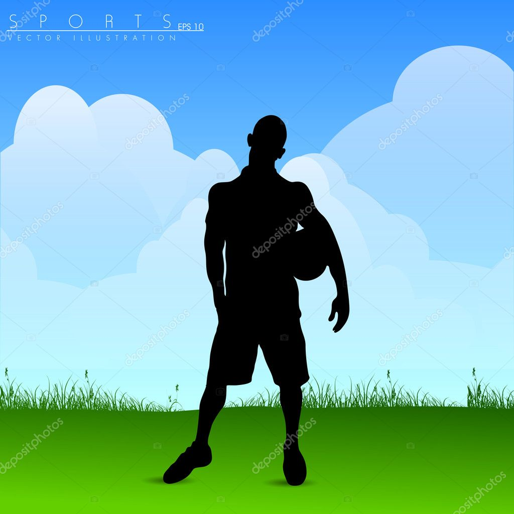 Silhouette of young football player holding soccer ball in hand