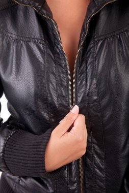 Woman unzipping black coat