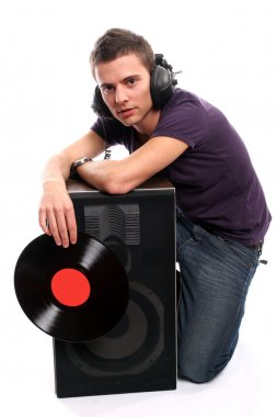 Dj in headphones holding a plate