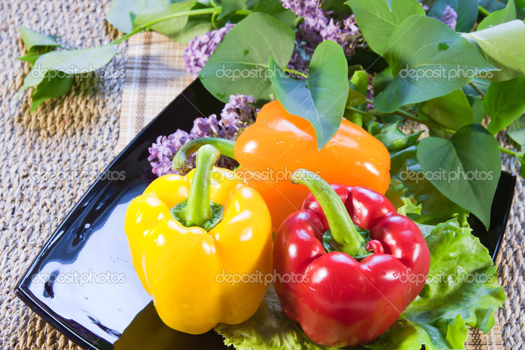 Bulgarian sweet pepper of red and yellow color and leaves of let