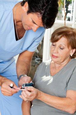 Male Nurse Measuring Glucose Level