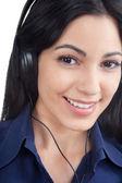 Fényképek Nő hallgat zenét a fejhallgató