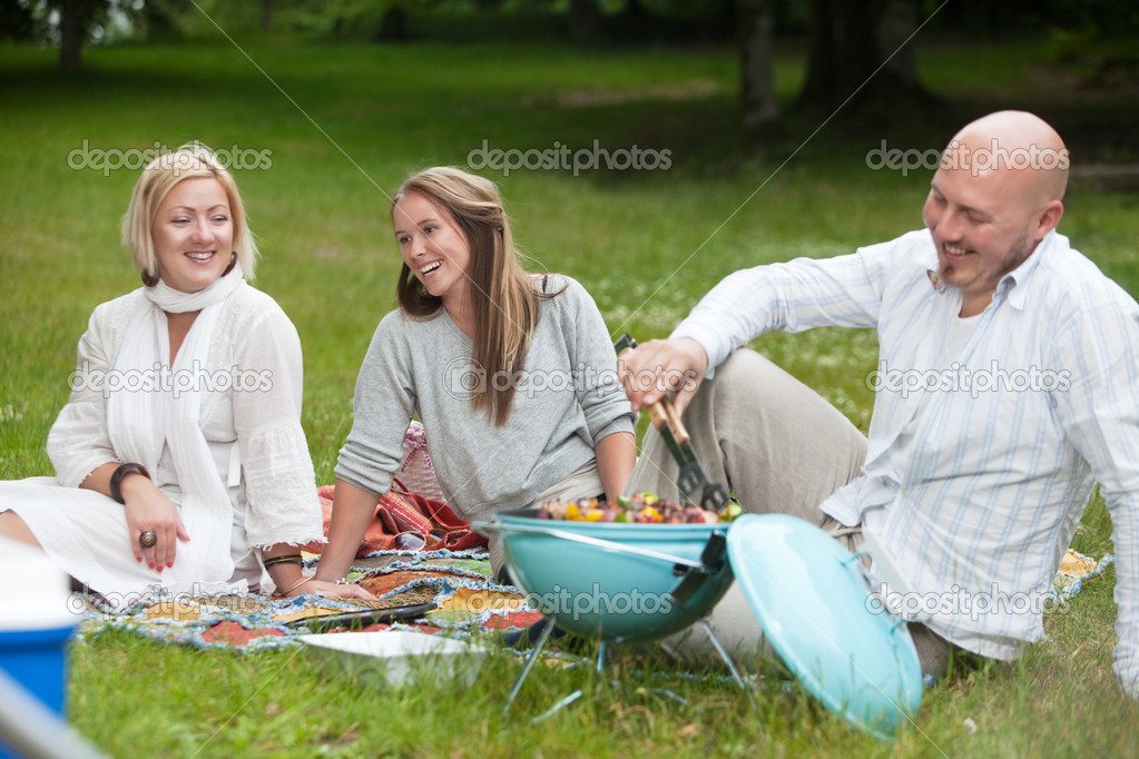 Friends with Barbecue in Park