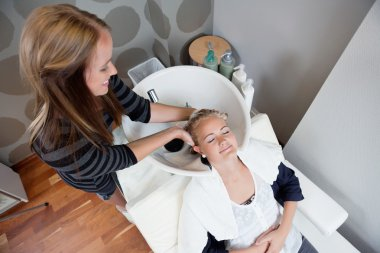 Woman Getting a Hair Wash Before Haircut