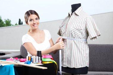 Female Fashion Designer Taking Measurement