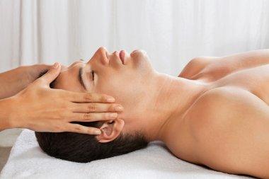 Man Receiving Head Massage At Spa