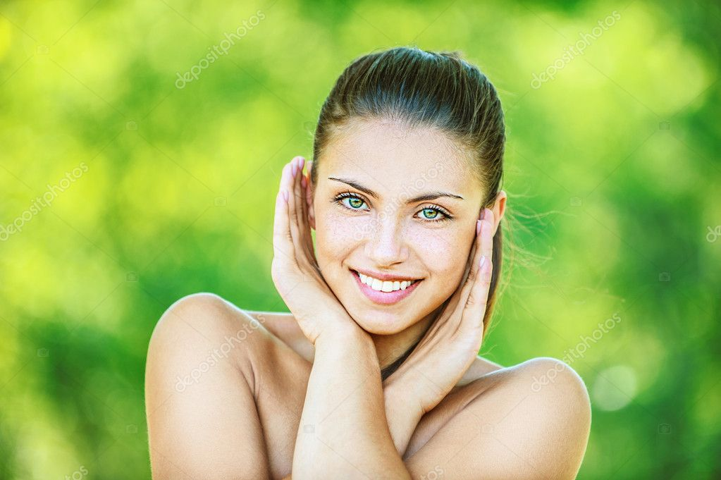 Beautiful woman crossed her arms and smilling