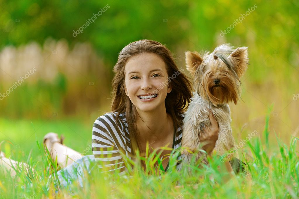 Smiling woman with Yorkshire Terrier