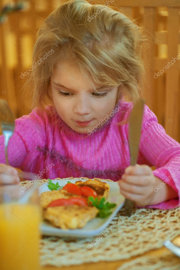 Girl-preschooler eats a tasty meal