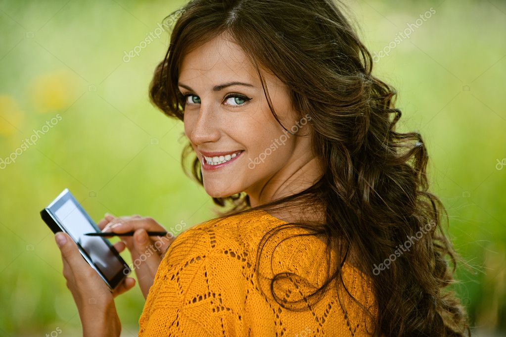 Woman is typing with stylus on device