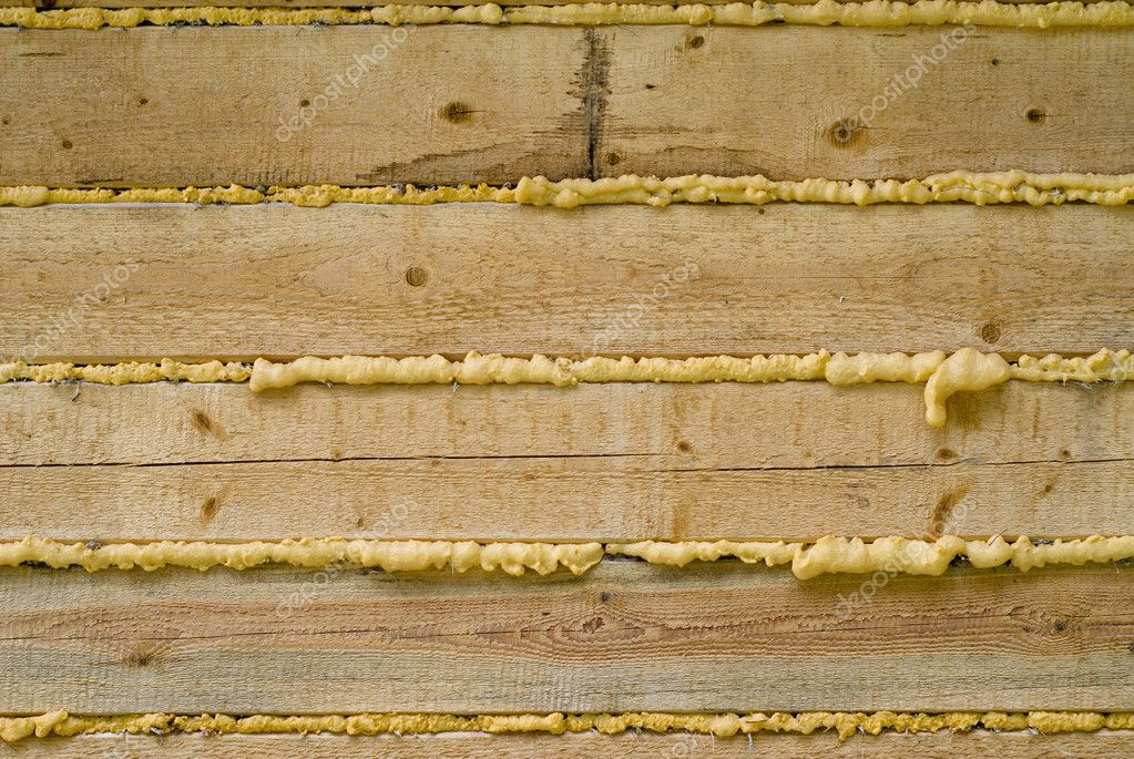 Close-up of Polyurethane foam filling gap in wooden construction