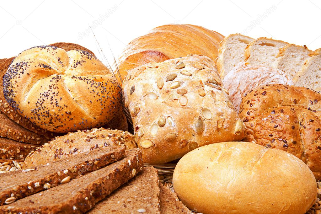 Assortment of baked bread over white