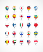 Fotografie Navigation pointer icons with world flags
