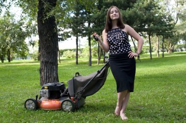 Girl with a lawn mower