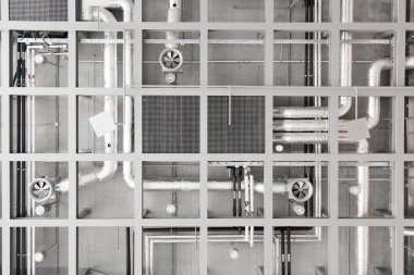 Pipes and fans on ceiling