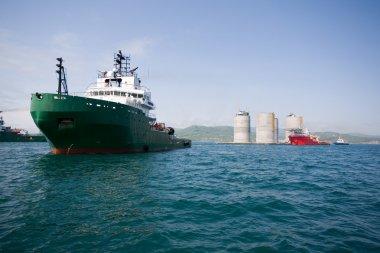 Ocean tugs towing base oil platform