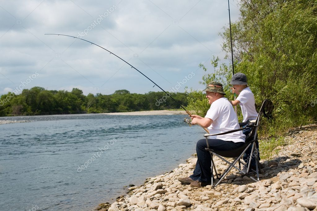 Grandfather and grandson go fishing