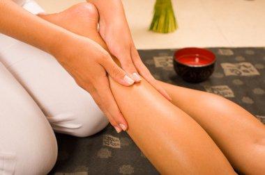 A therapist massaging a leg