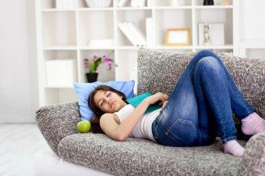 Beautiful teenage girl sleeping on sofa