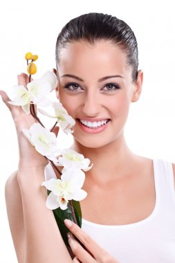 Smiling woman with white orchid
