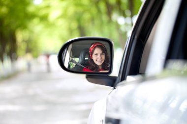 Smiling woman driving