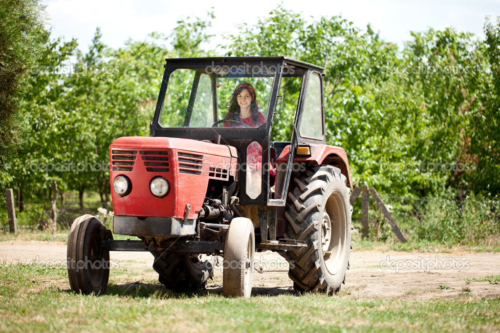 Young girl driving tractor