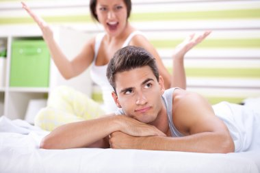 Couple having an argument in the bedroom