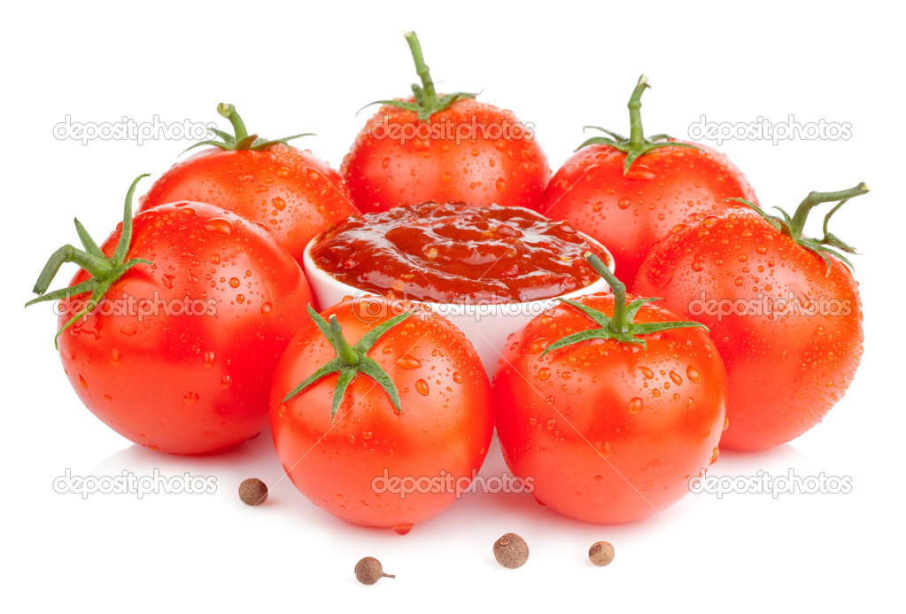 Bowl with fresh ketchup and six wet juicy ripe tomatoes isolated
