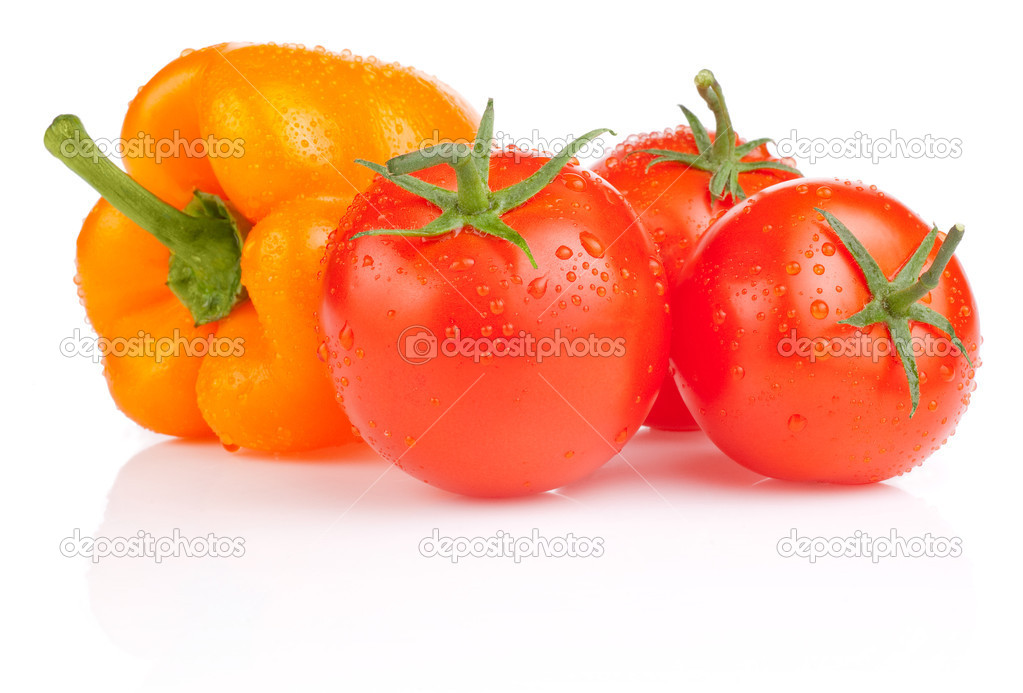 Wet Tomatoes and Yellow Bell Pepper with drops isolated on white