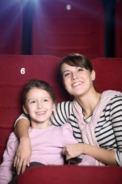 Mother and child at the cinema