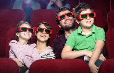 Smiling family in the 3D movie theater stock vector