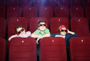 Smiling kids watching cartoons at the cinema stock vector