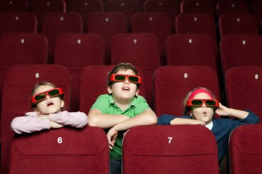 Surprised children watching a movie at the 3D cinema stock vector