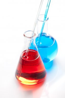 Two glass flasks with a colored liquid