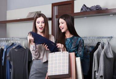 Two girlfriends go shopping