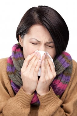 A cold young attractive woman holding wipe
