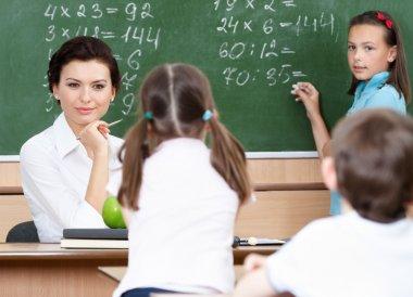 Teacher questions pupils at mathematics