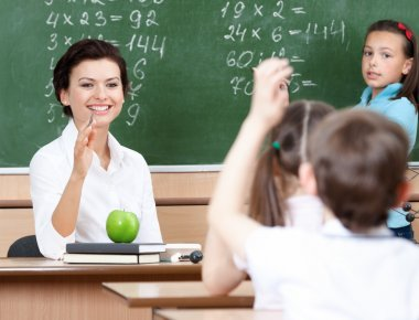 Teacher questions pupils at algebra