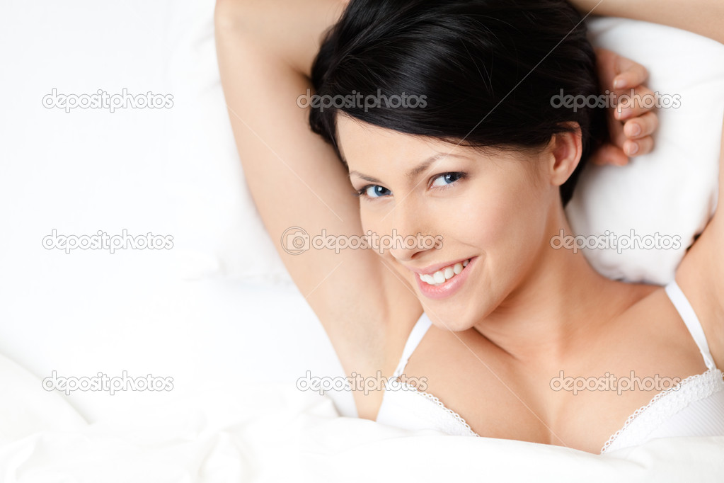 Sleeping woman in the wide bed