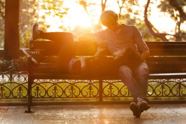 Young couple on the bench at the street.