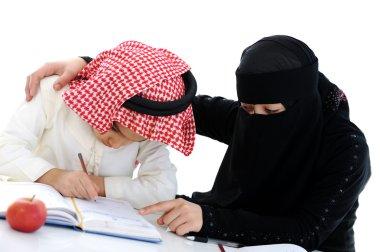 Muslim Arabic boy and girl doing homework